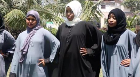 شابة صومالية تتحدى المنتجات المستوردة بأزياء محجبة