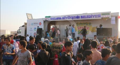 سيرك وألعاب وأغانٍ.. متطوعون أتراك يبهجون مئات الأطفال السوريين بريف حلب